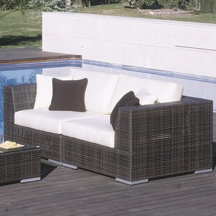 Soho Loveseat with Cushions by Hospitality Rattan
