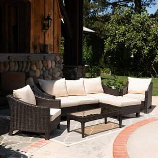 Winchell Outdoor 7 Piece Rattan Sectional Seating Group with Cushions