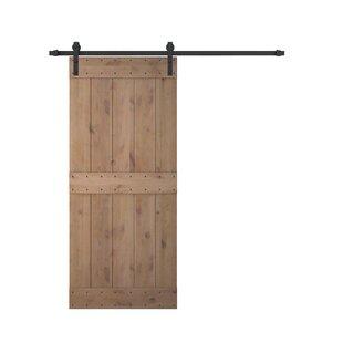 Bent Strap Sliding Door Track Hardware And Vertical Slat Primed Knotty Solid Wood Panelled Alder Slab Interior Barn
