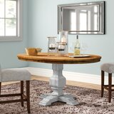 Hermitage Extendable Solid Wood Dining Table by Three Posts