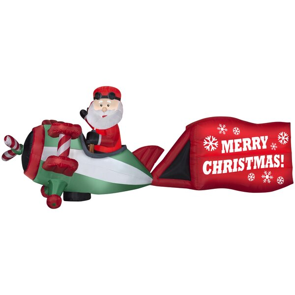 the holiday aisle santa on airplane with sign merry christmas