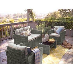 Savings Aguero 4 Piece Outdoor Rattan Sofa Seating Group with Cushions Inexpensive