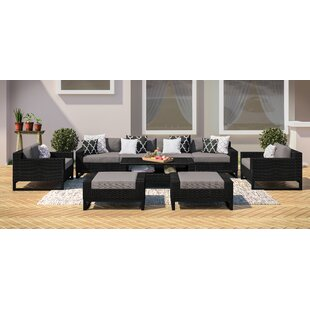 Stivers Rattan 9 Piece Sectional Seating Group with Cushions