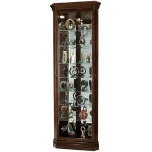 Drake Lighted Corner Curio Cabinet by Howard Miller®