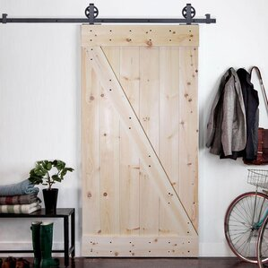 solid wood panelled knotty pine slab interior barn door