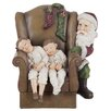 The Seasonal Aisle Chair and Child and Santa Claus Figurine