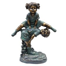 Girl Jumping Over Boy Statue