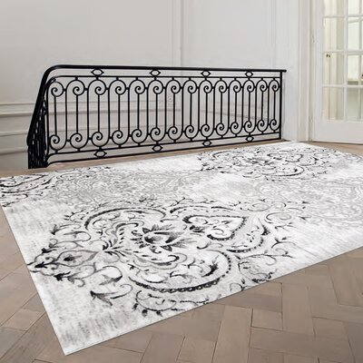 fleur de lis living abbate venetian grey/white area rug & reviews