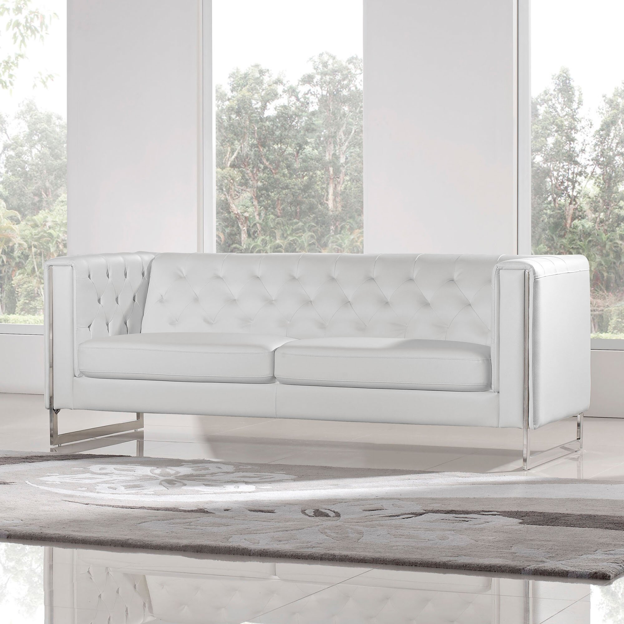 and tight diamond the sofa features clean contemporary axis sweeping back lines tufted track pin a with